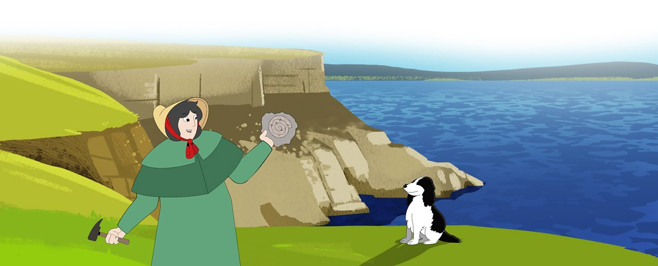 Mary Anning on the cliffs with her dog. She is holding a fossil.