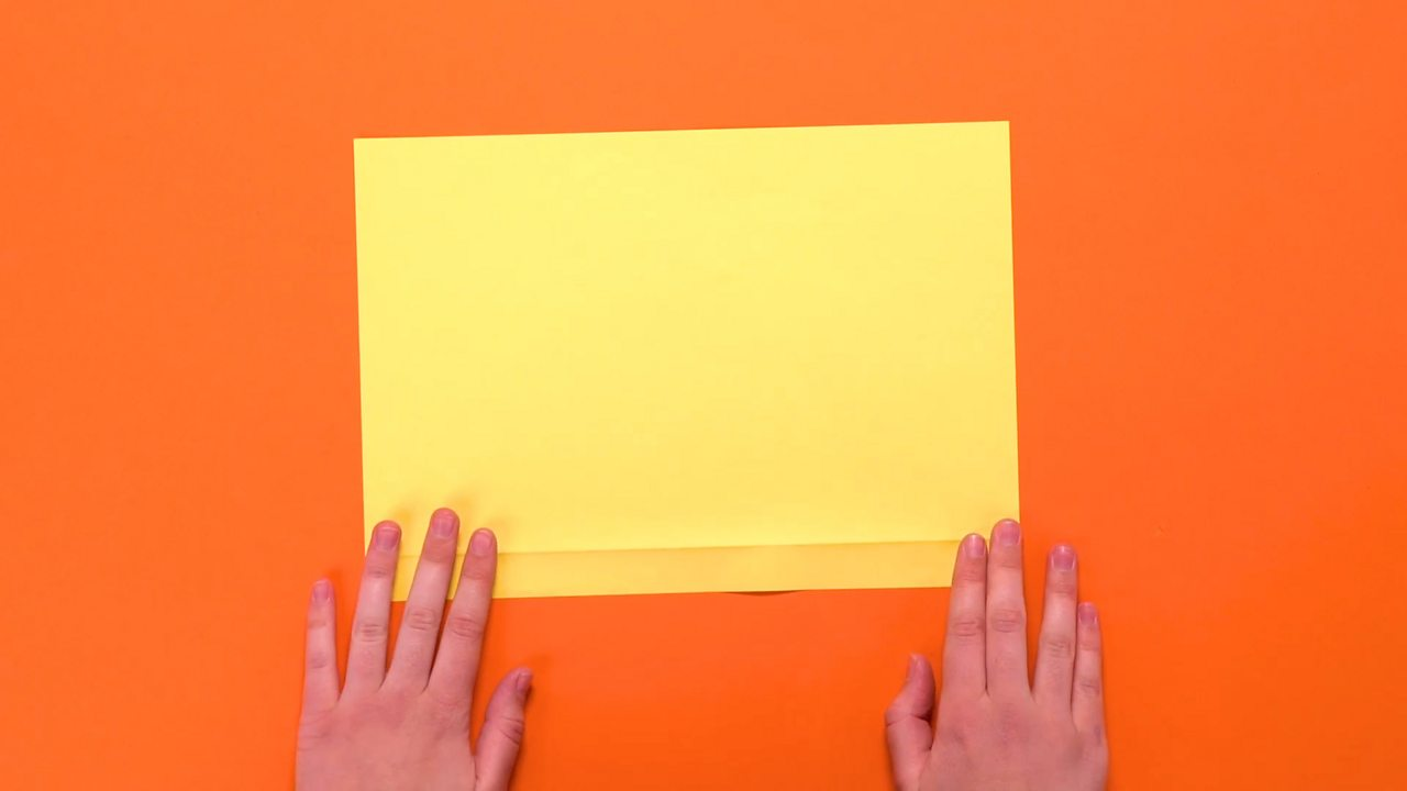 An A4 sheet of paper with a thin strip at the bottom folded over.