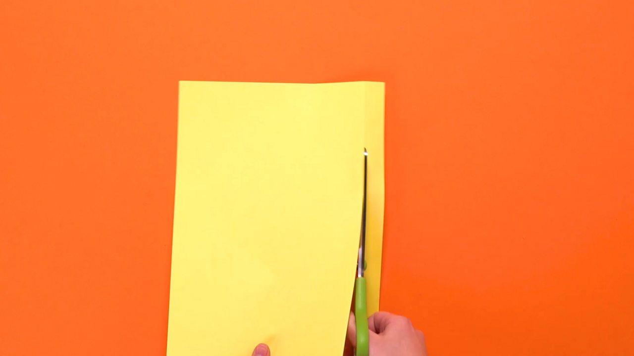 An A4 sheet of paper being cut.