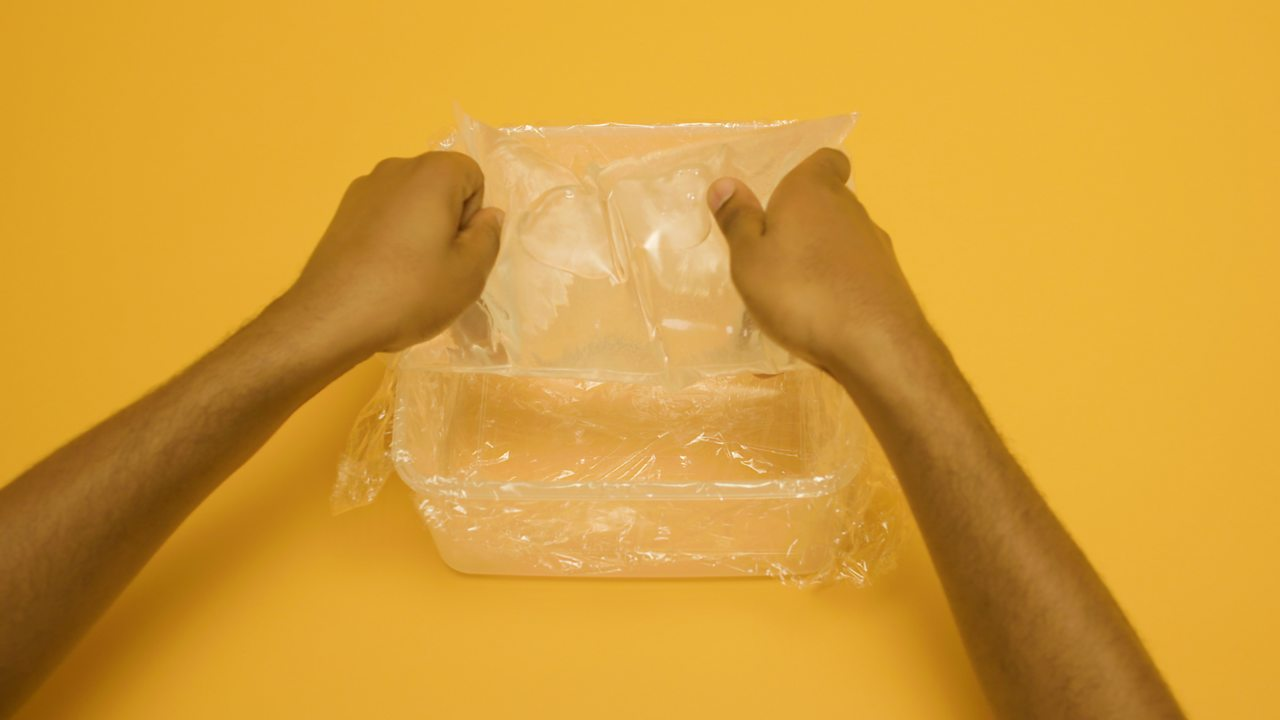 A person adding the bag to the box