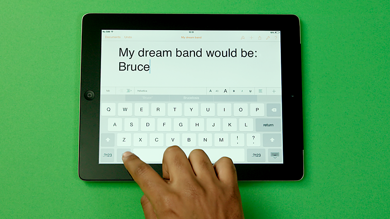 A person typing a list of who would be in their dream band.