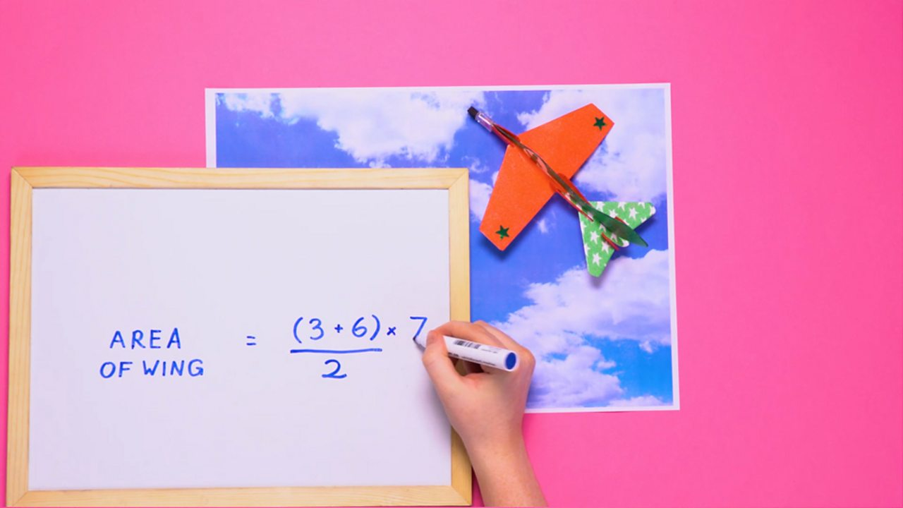 Toy plane and a formula for the area of its wing: (3 + 6) ÷ 2 × 7