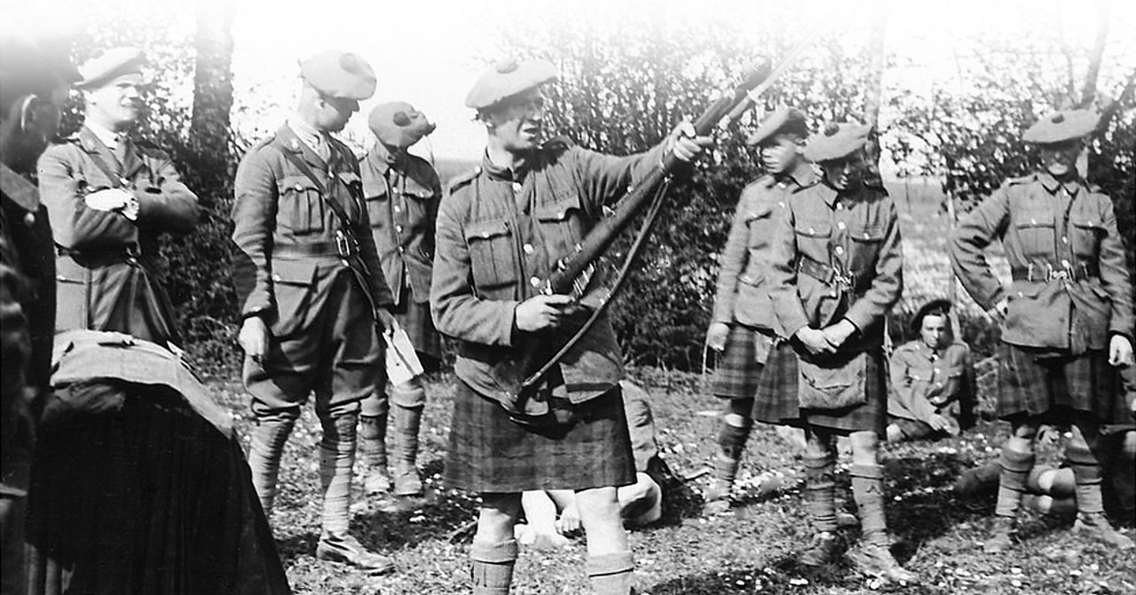 Top fading image of Scottish soldiers taking a break on the Western Front in World War One