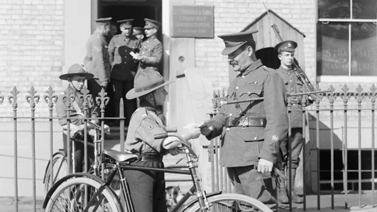 A boy scout delivering a message to a solder at the war office in World War One