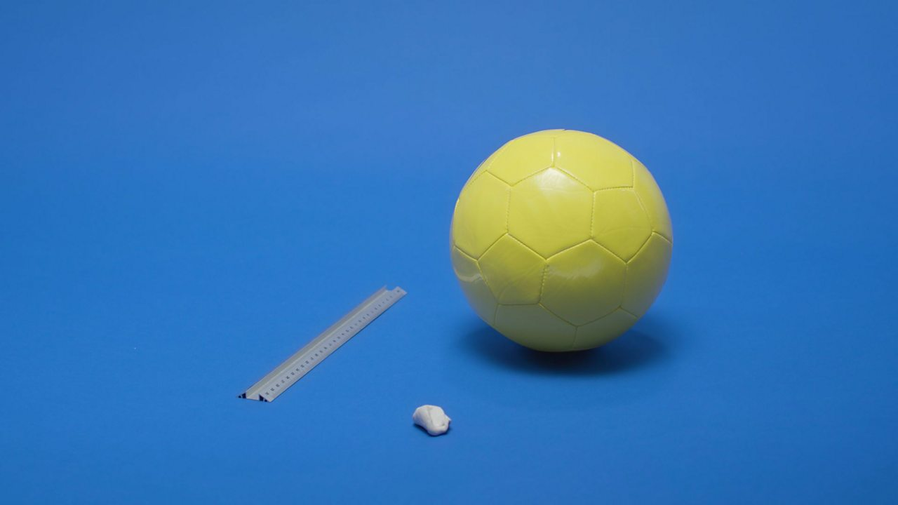 WHAT YOU NEED: A ruler, a football (approximately 22 cm) and some sticky tack.