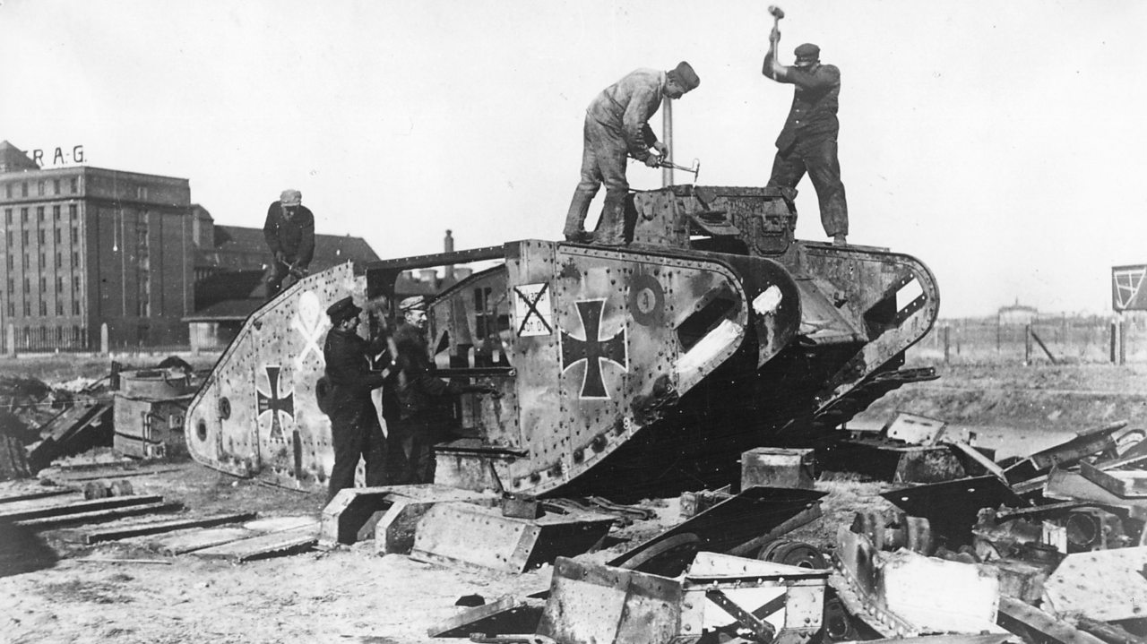 Germans taking a tank apart outside Berlin in 1919 as ordered by the Treaty of Versailles