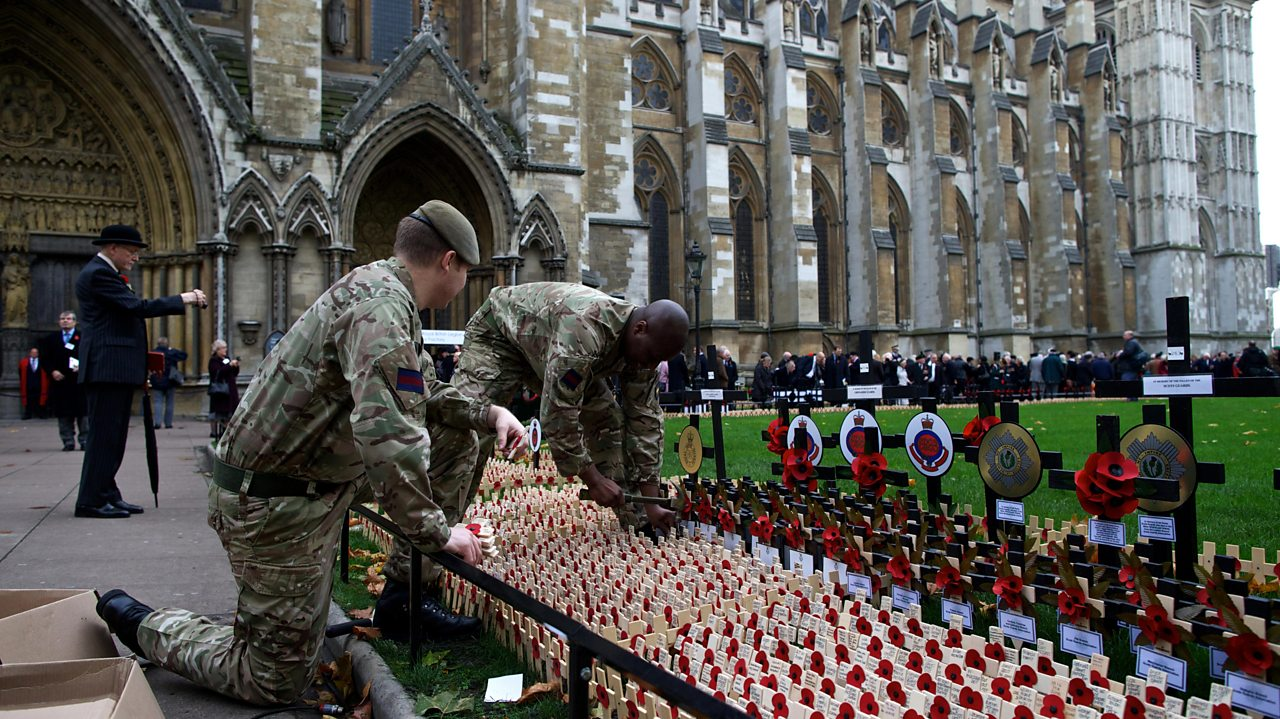 British Army personnel place crosses of remembrance outside Westminster Abbey 7 November 2013