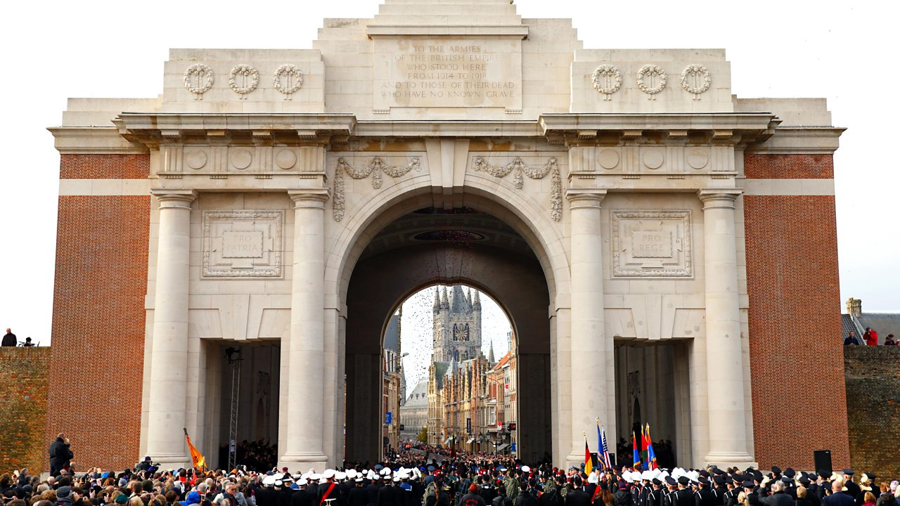Poppies drop from the roof of the Menin Gate during a ceremony to mark Armistice Day on 11 November 2013 in Ypres, Belgium