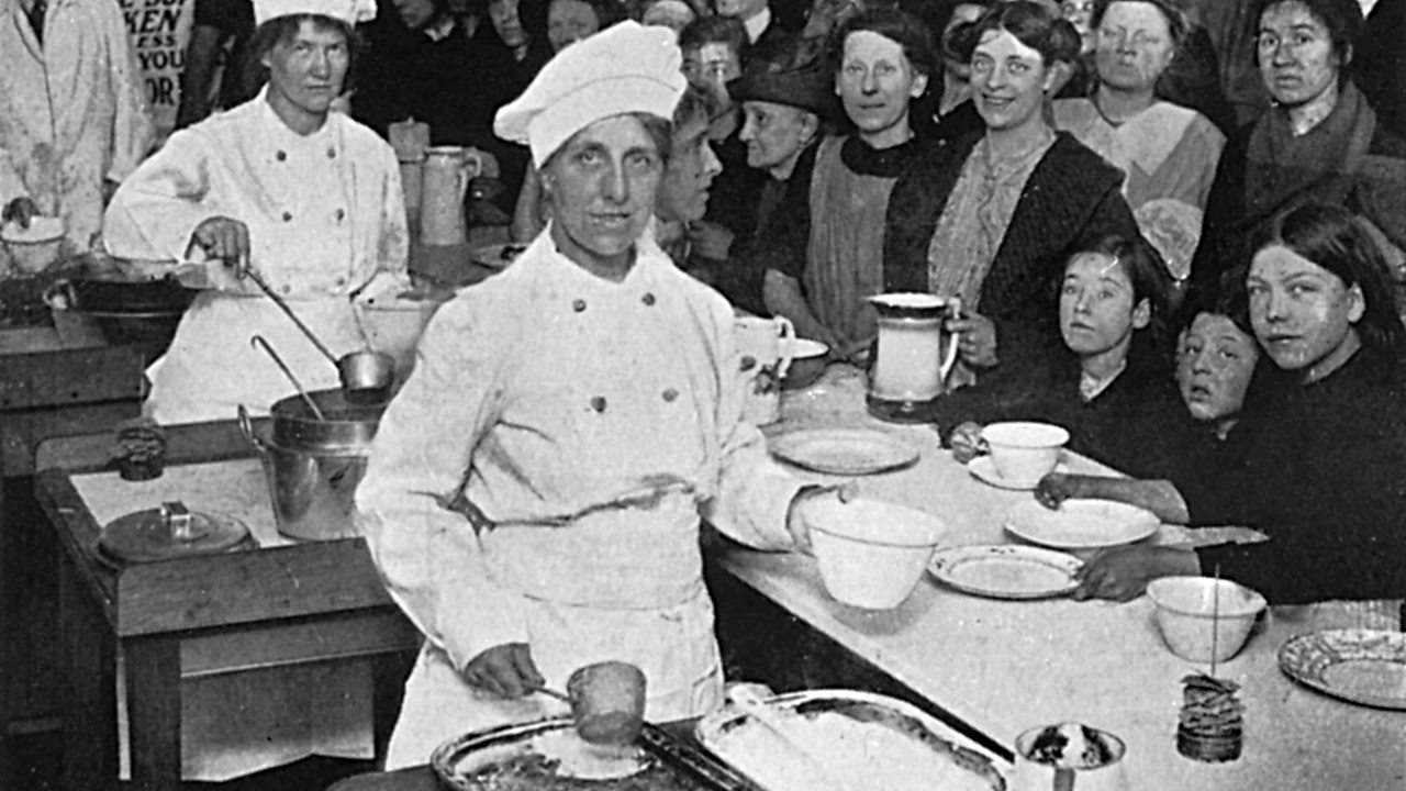Workers in a National Kitchen serving food to people during World War One