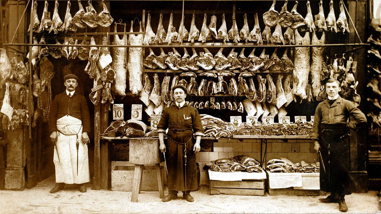 A photograph of three butchers outside their shop front in World War One