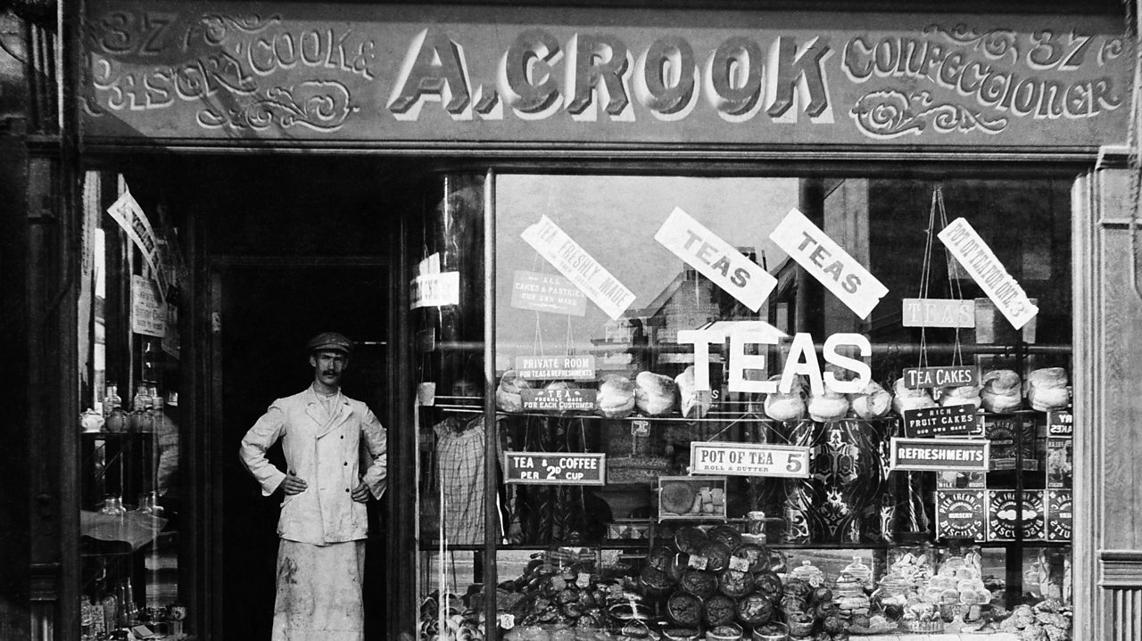 A photograph of a confectioner outside his shop front in World War One