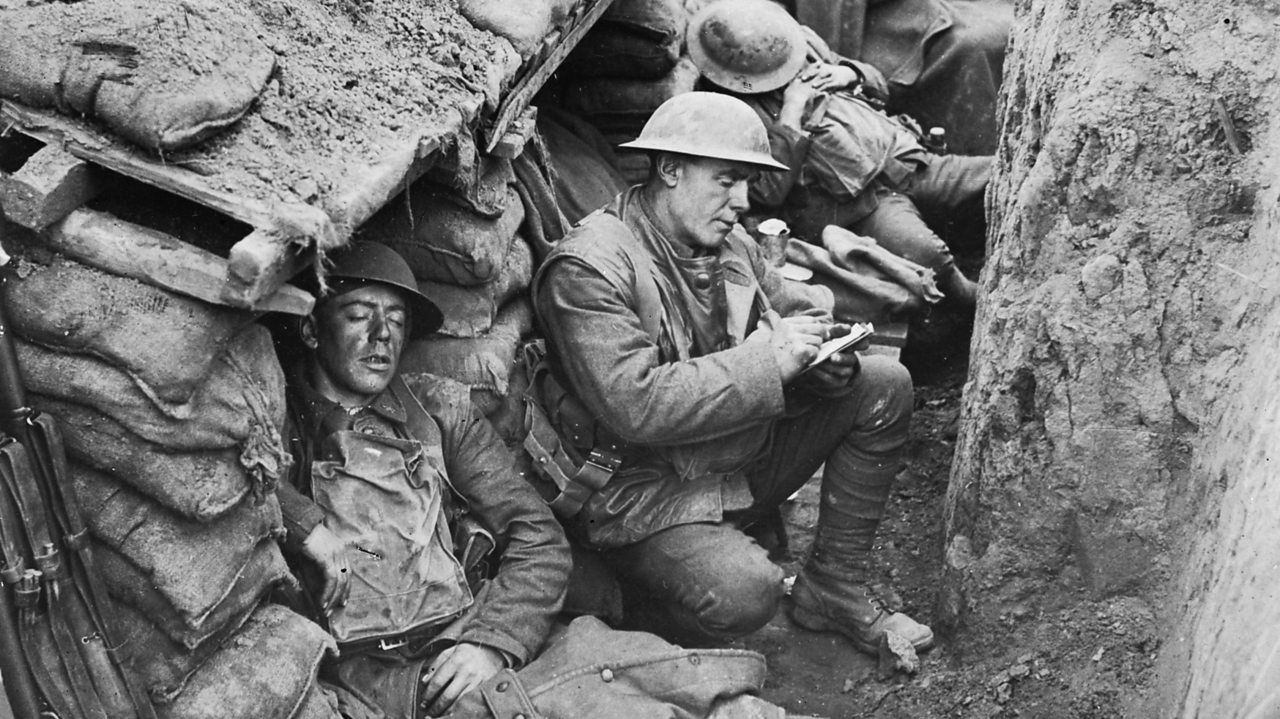 Canadian soldiers sleeping and writing letters in a World War One trench.