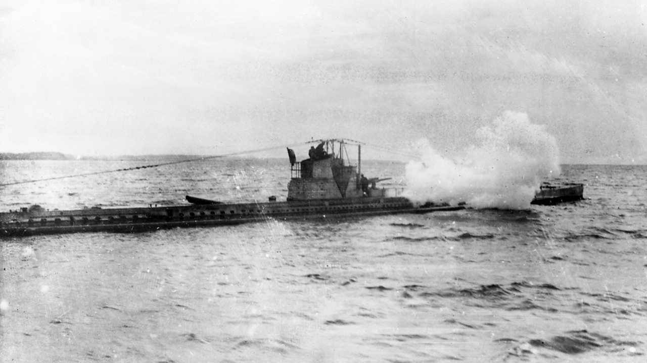 A British submarine in action in World War One, firing its gun