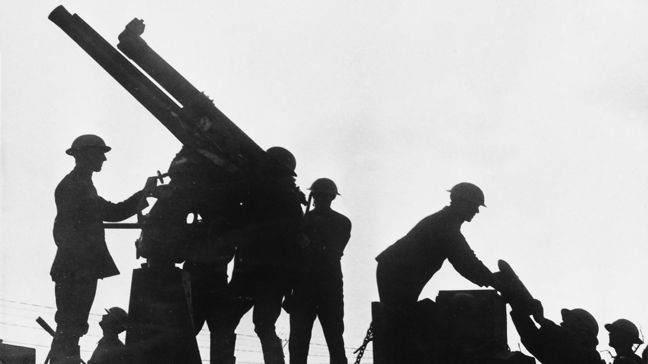 Silhouette of soldiers firing an anti-aircraft gun mounted on a lorry in the Battle of Broodseinde, Flanders