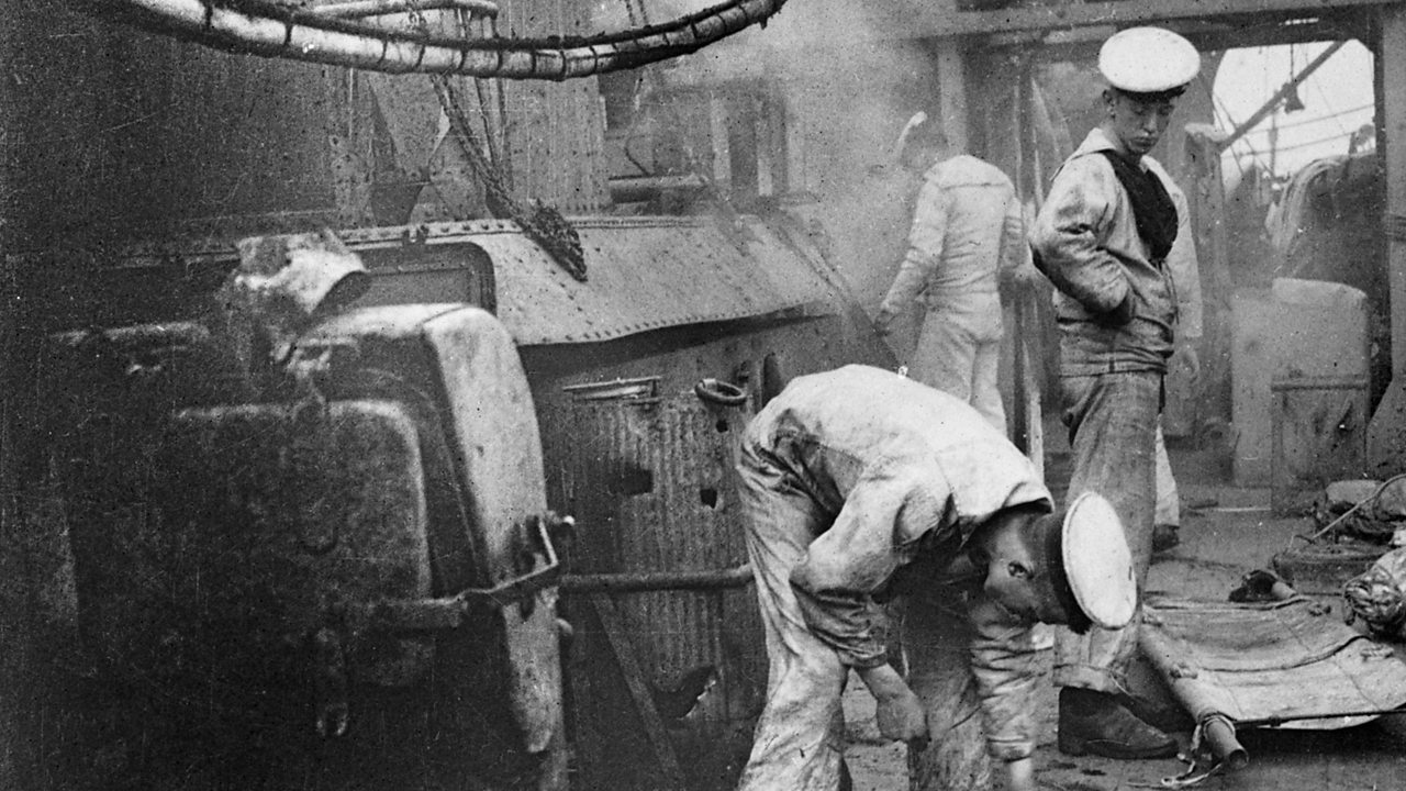 Sailors cleaning the deck of a ship during World War One