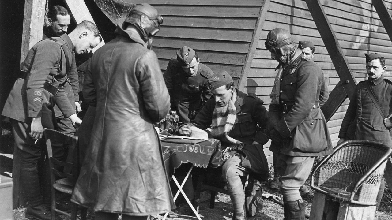 British pilots handing in reports after flying over enemy lines in World War One