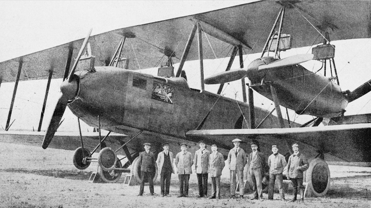 A large aircraft with observers in the early 1900s