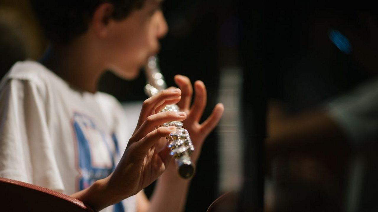A boy playing a flute