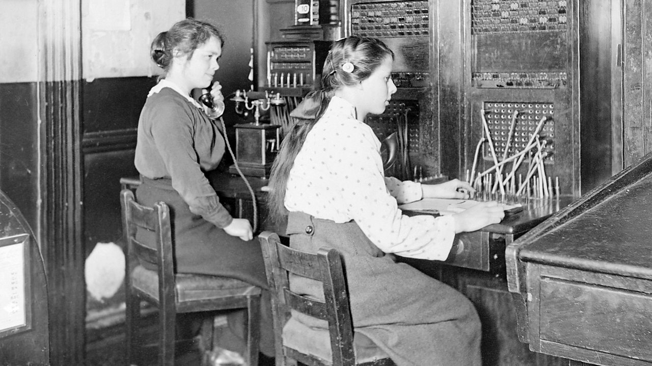 Two women operate a telephone exchange switchboard during World War One