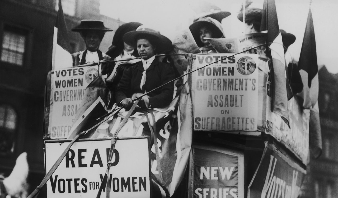 A large carriage full of suffragettes campaigning in London in 1910