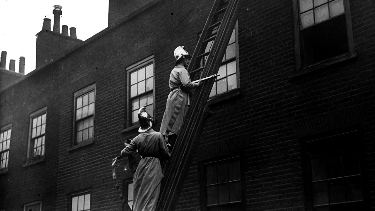 Members of the Women's Fire Brigade on a fire drill with hoses and extinguishers in March 1916