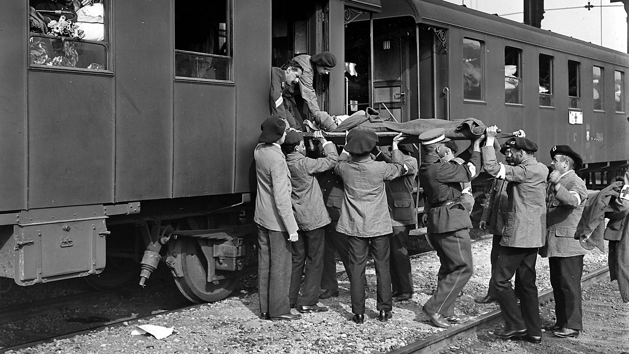 World War One ambulance train workers unload injured soldiers from the train