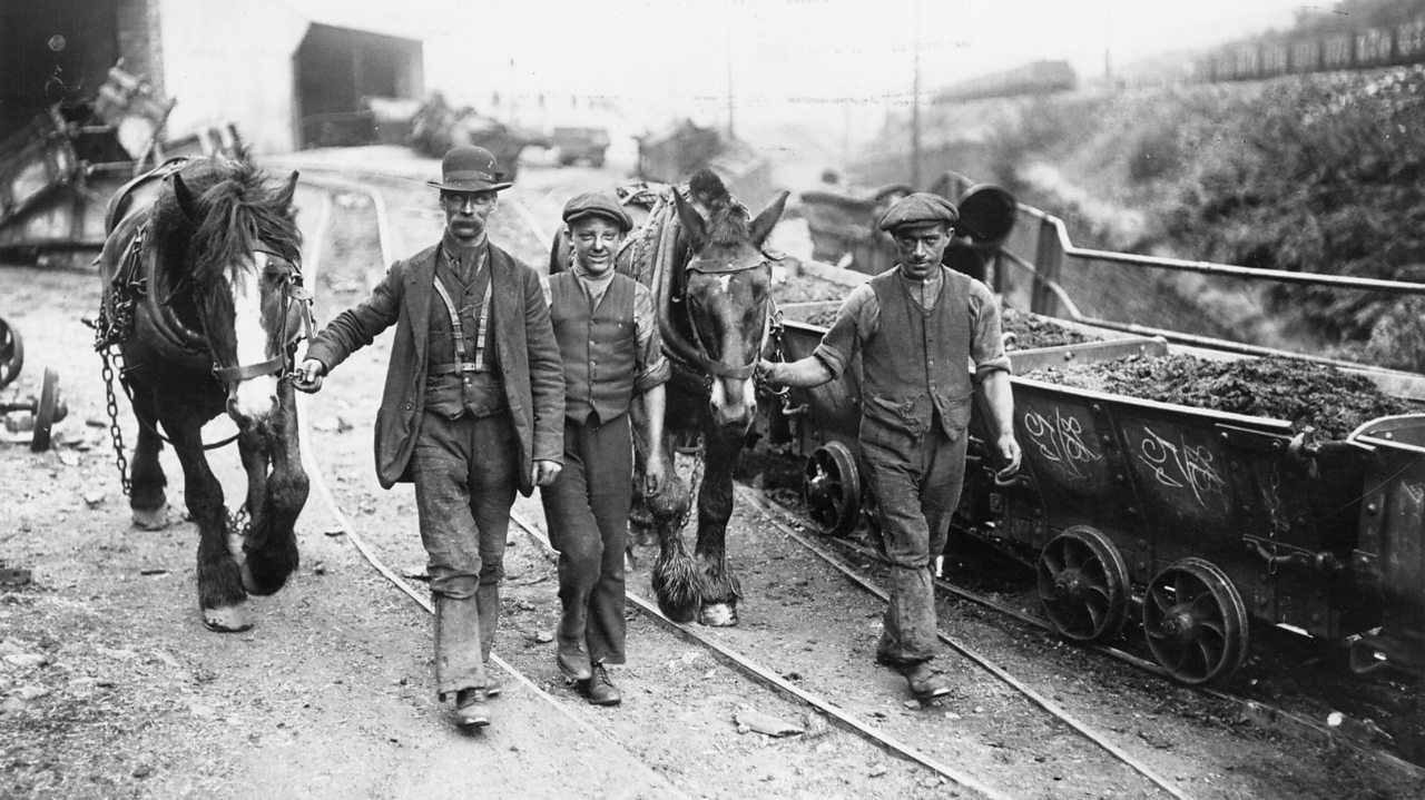 Three miners with pit ponies in the early 1900s
