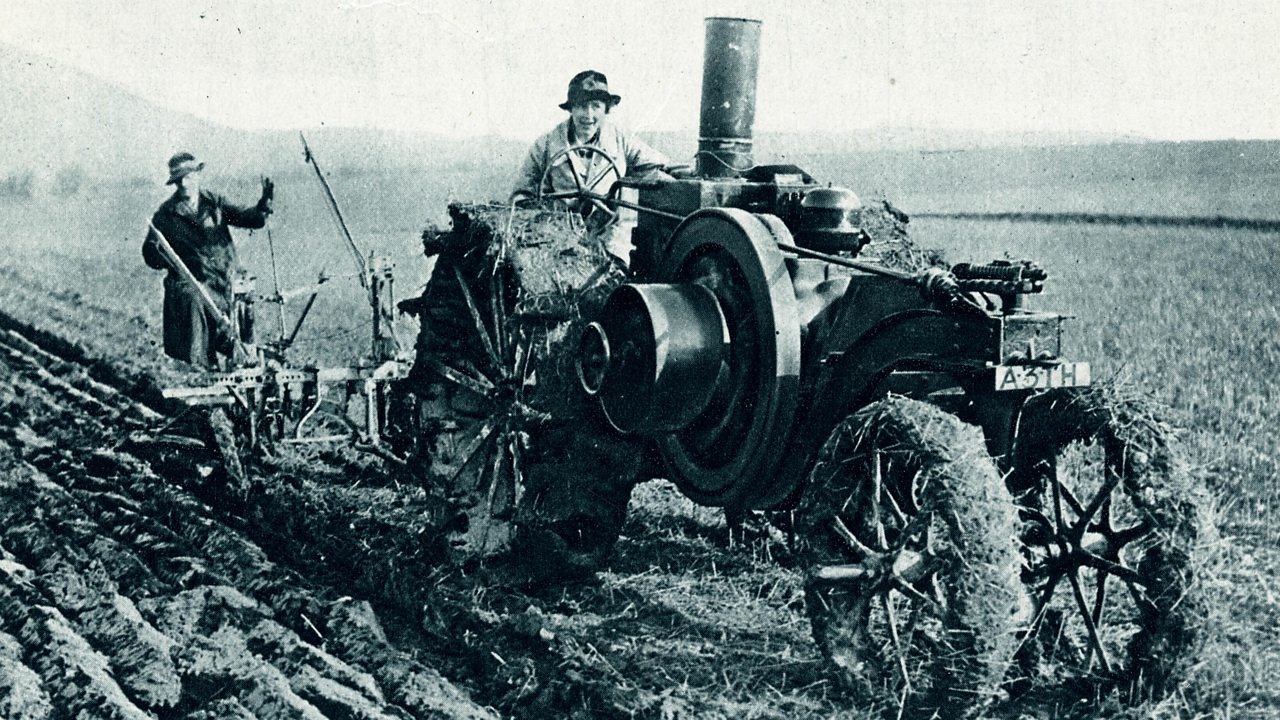 A farmer and his wife at work on a specially built tractor in the early 1900s