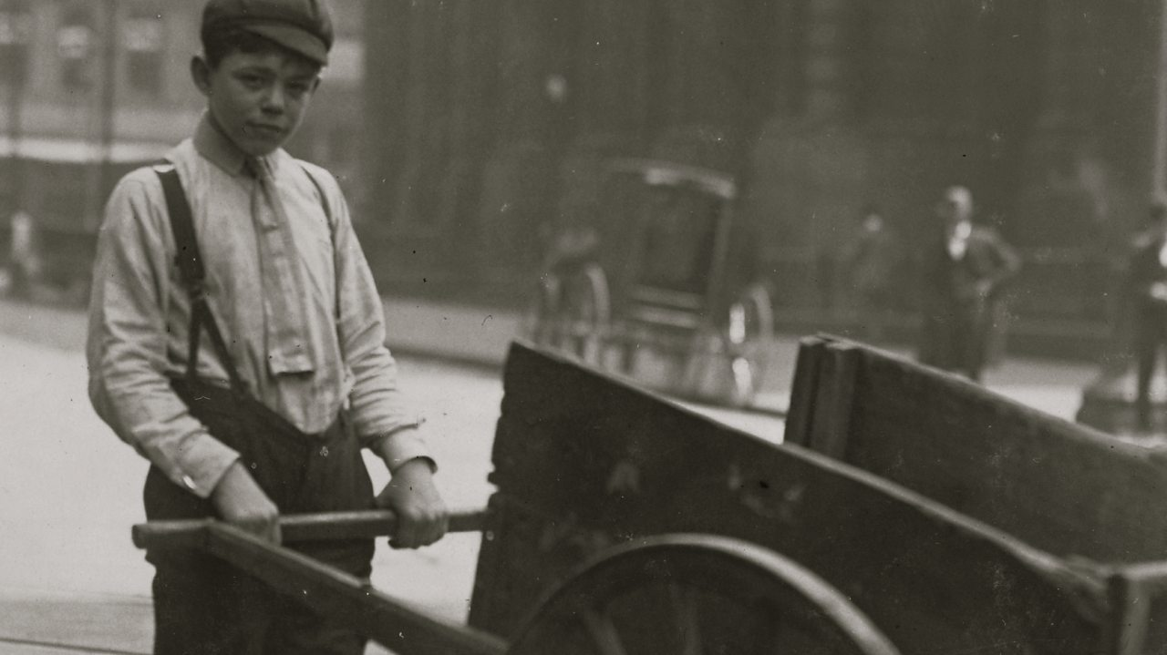 A delivery boy with a barrow in Britain in the early 1900s