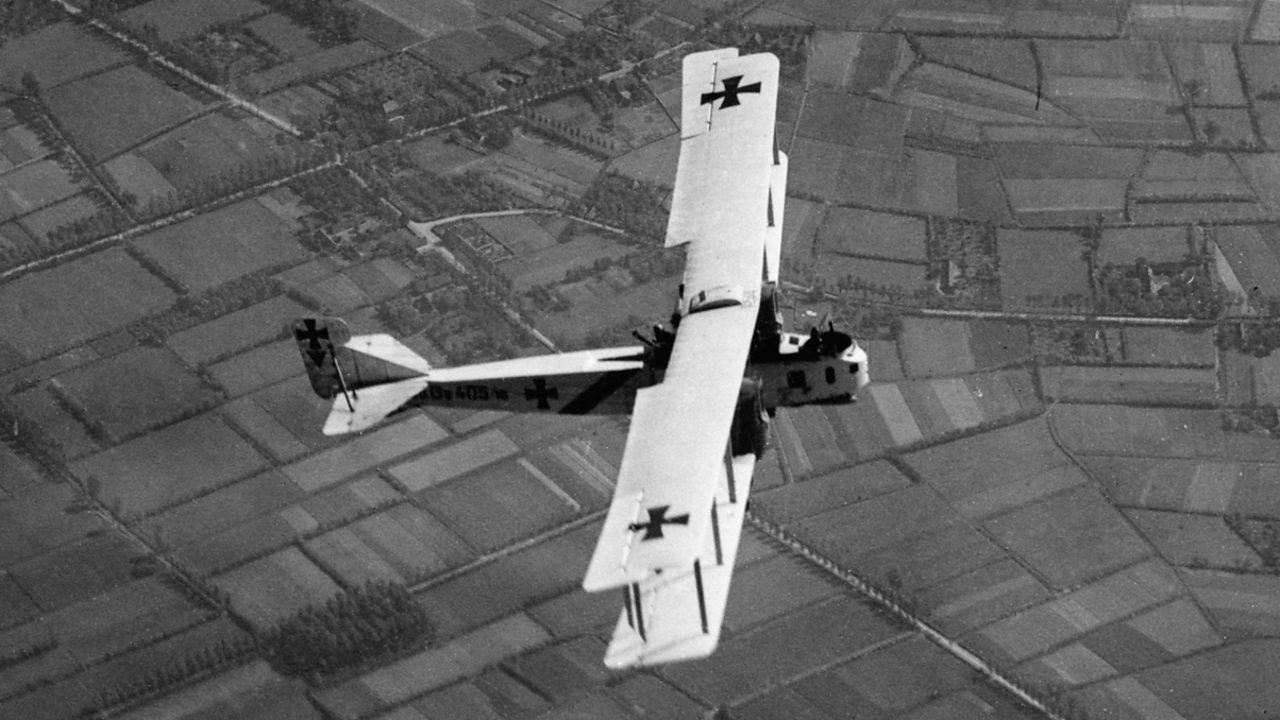 A German Gotha bomber flying over fields during World War One