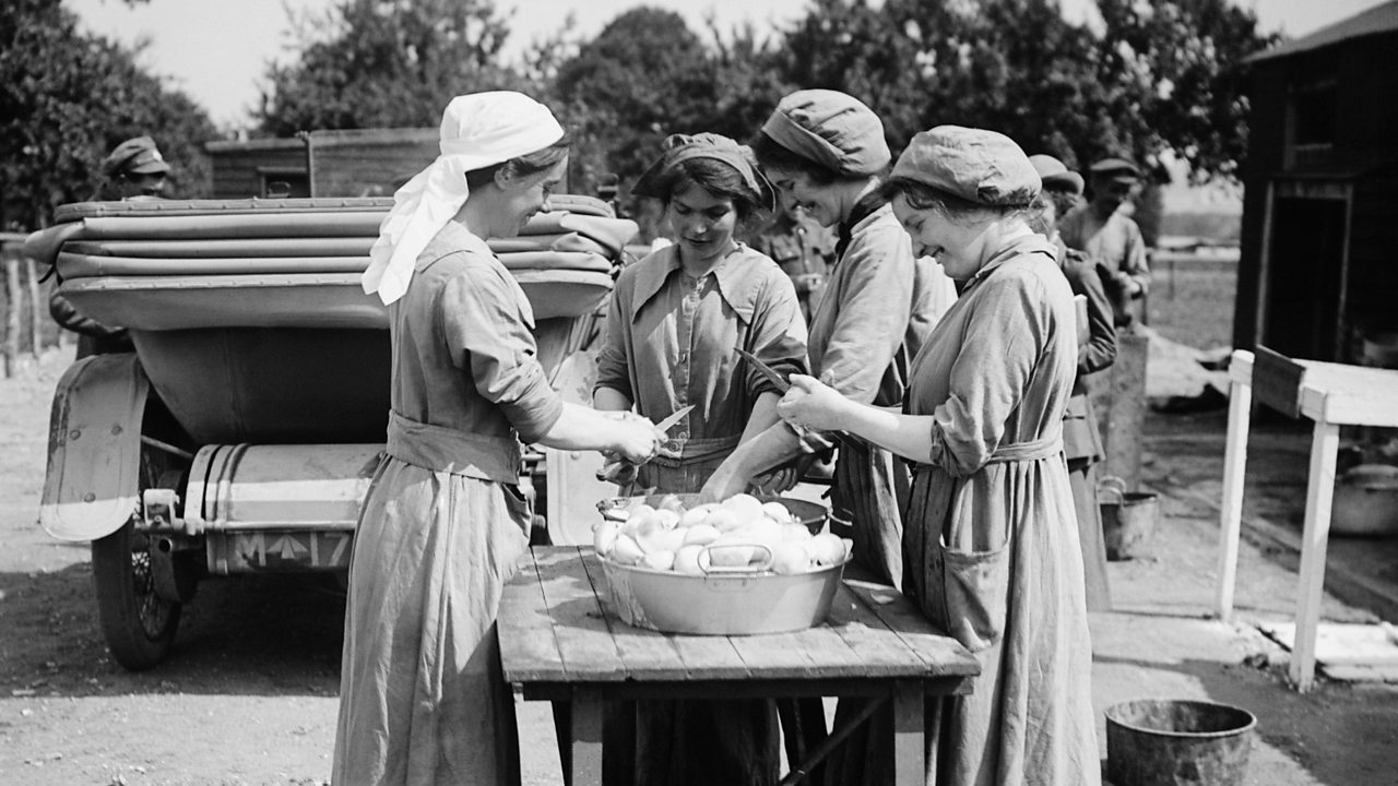 Four women preparing food for soldiers outside an army camp in World War One