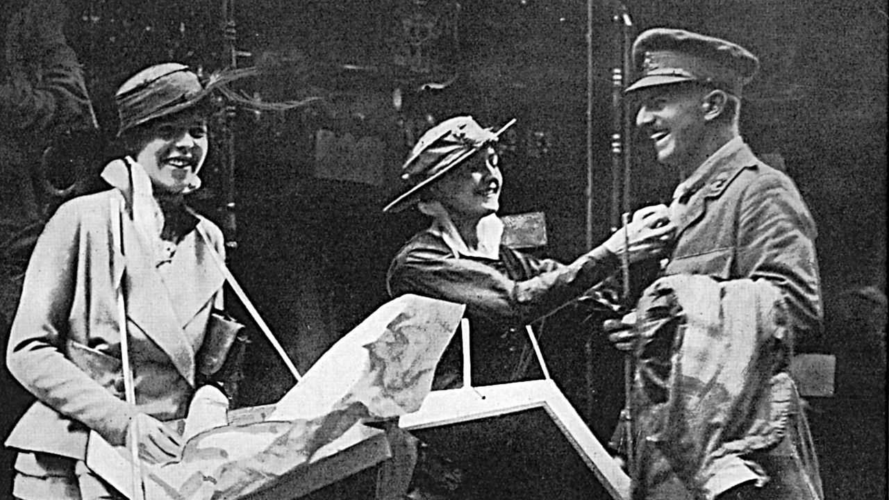A photograph of two girls selling little flags to a soldier in World War One