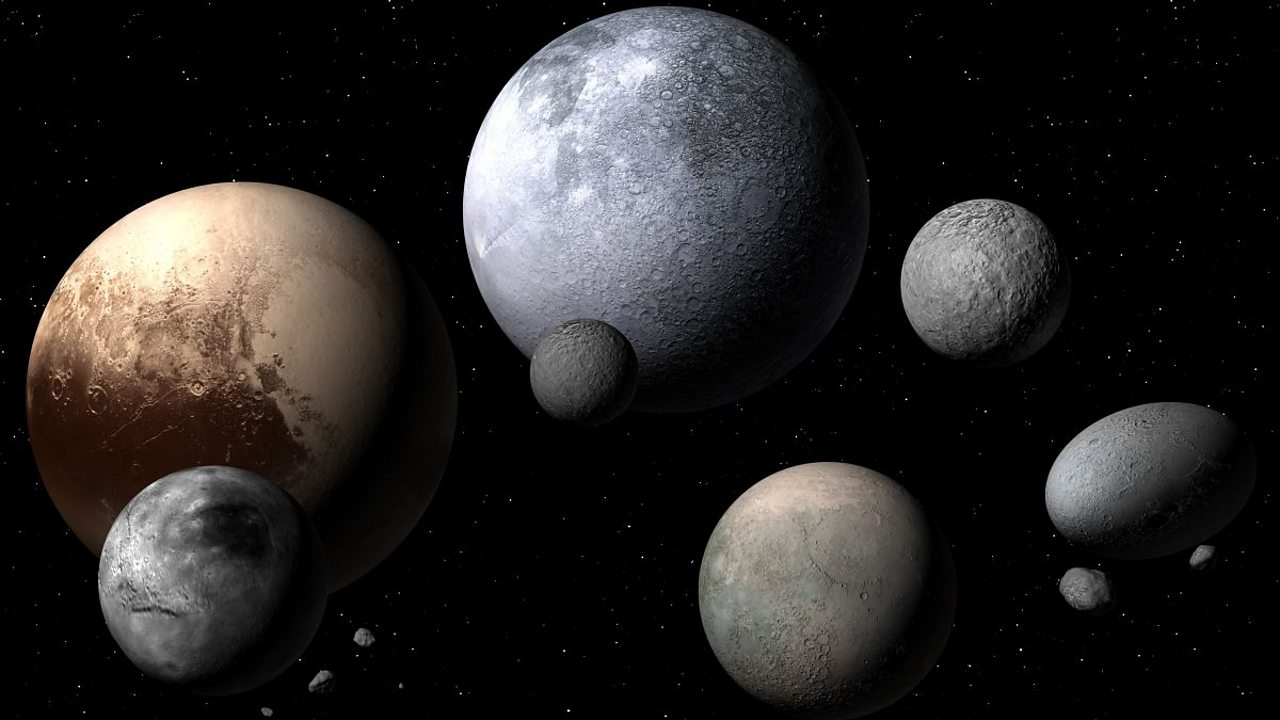 An artist's impression of the five dwarf planets.