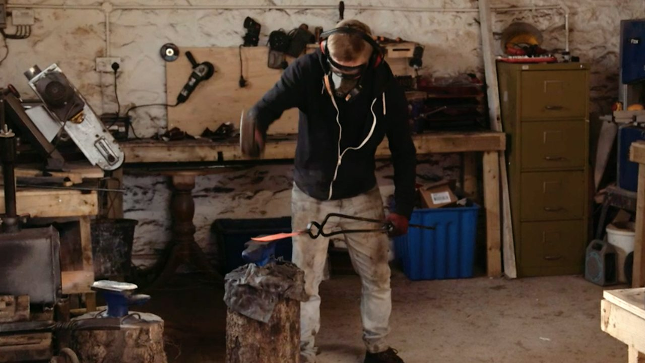 Dan forging a knife on an anvil with his hammer