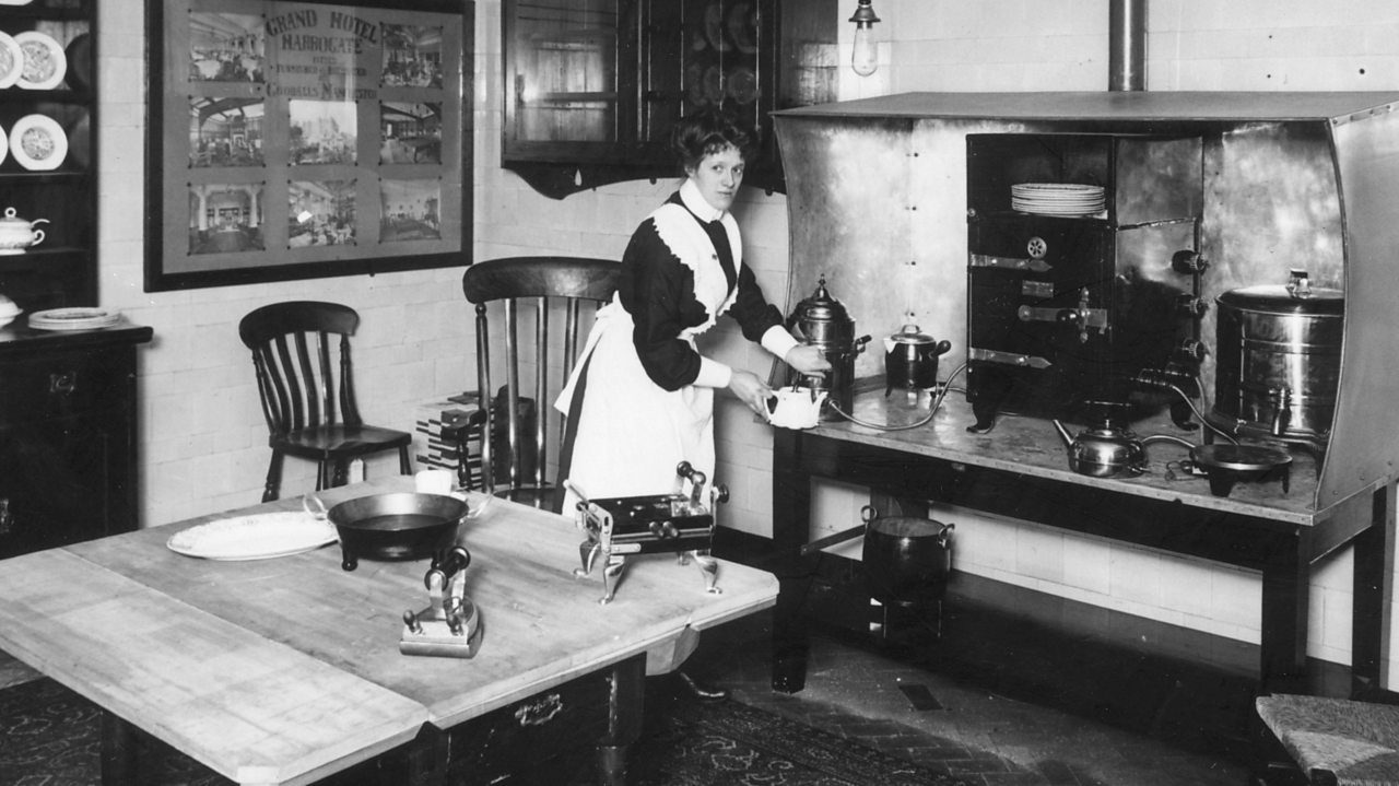A domestic servant in a kitchen fitted with electricity in the early 1900s