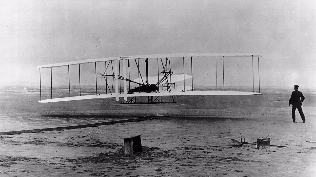 The Wright Brothers plane in flight over North Carolina.