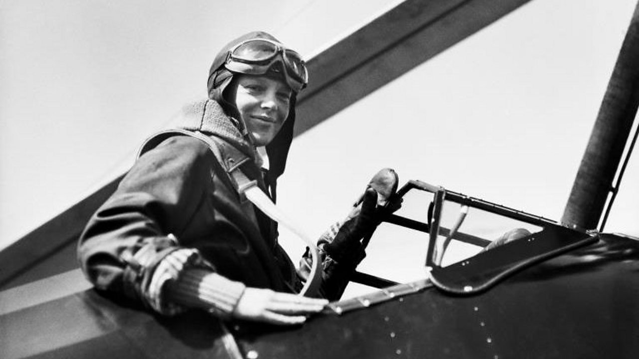 Pilot Amelia Earhart in the cockpit of her plane.