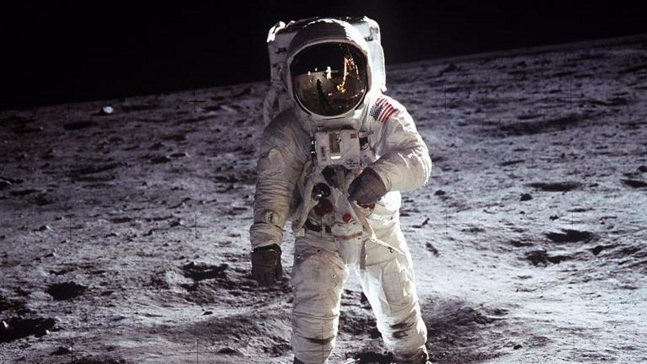 Buzz Aldrin walking on the moon during the Apollo 11 mission.