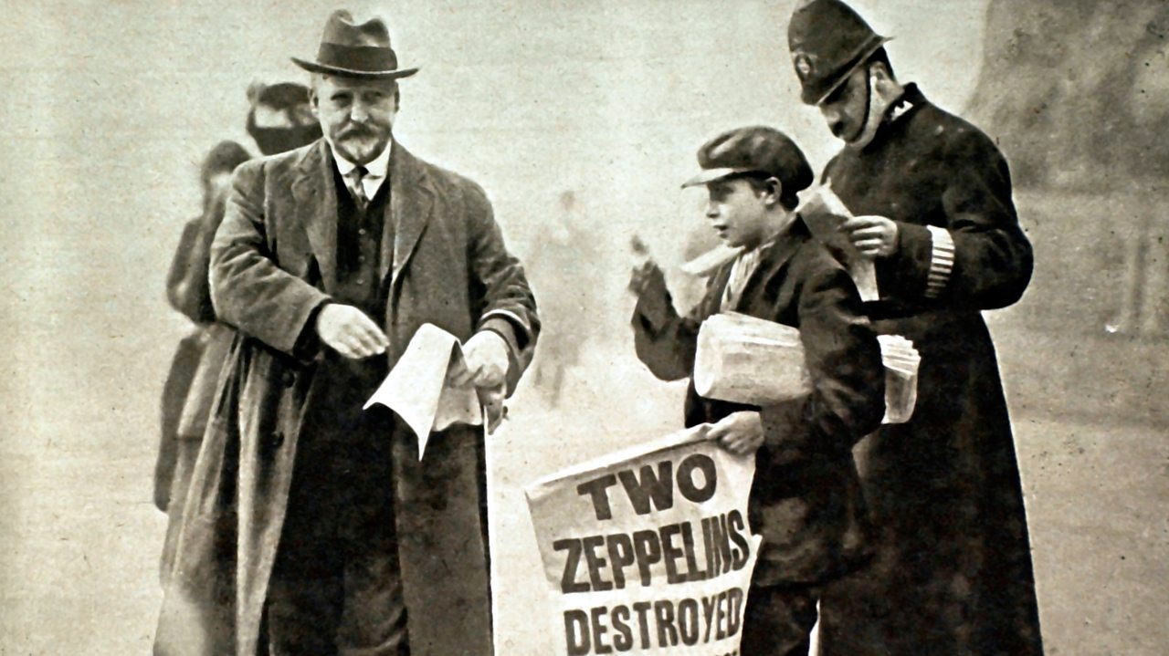 A child on a street selling newspapers to passers-by during World War One