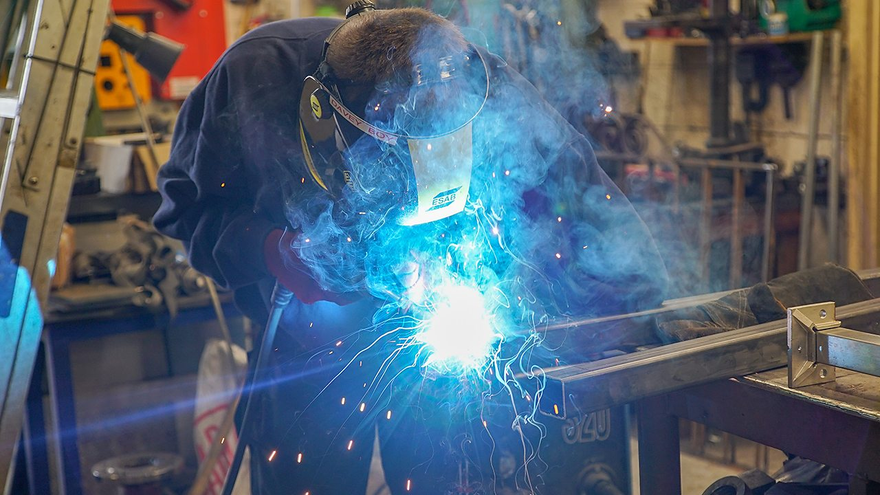 A young man, Billy, welding