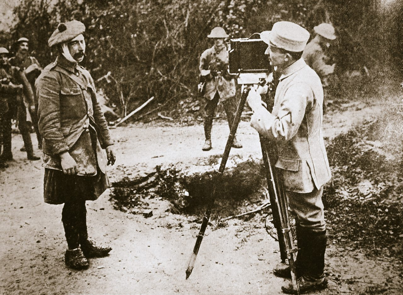 A French cameraman films a wounded Scottish soldier at the Battle of the Somme in 1916