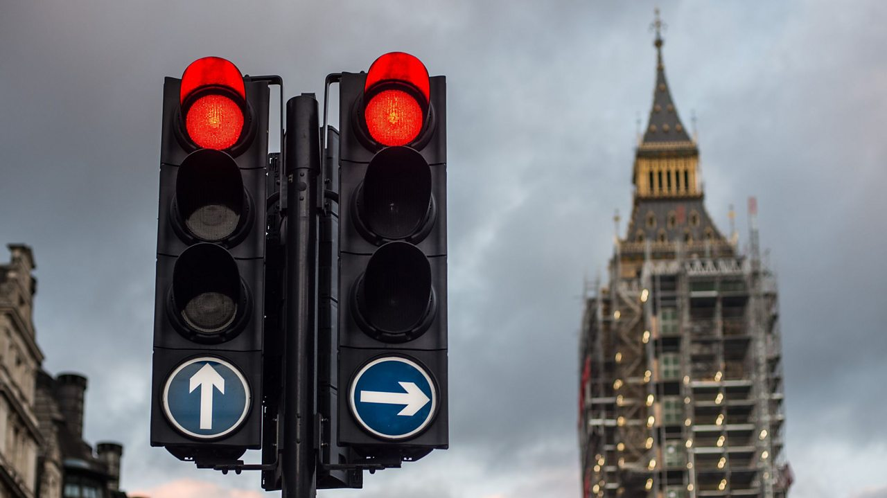 Red traffic lights near the houses of parliament