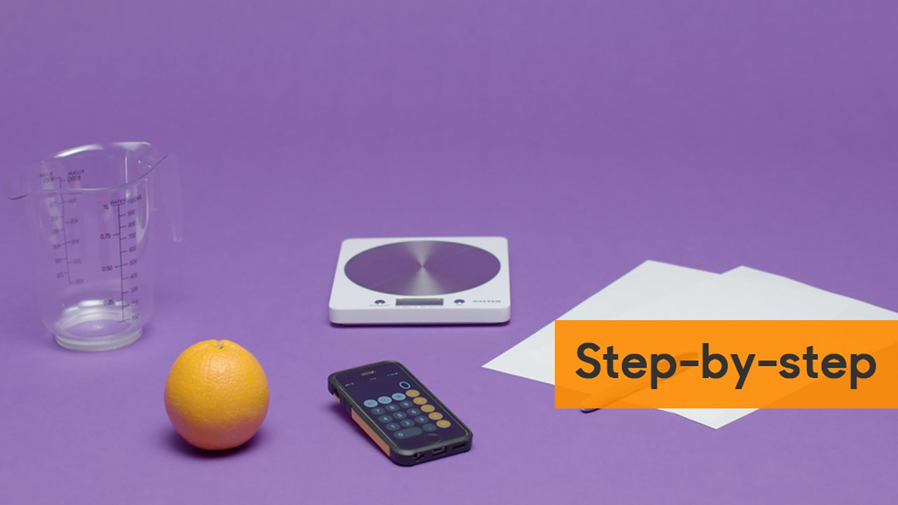 Image showing an orange, measuring jug, scales, calculator and sheets of paper