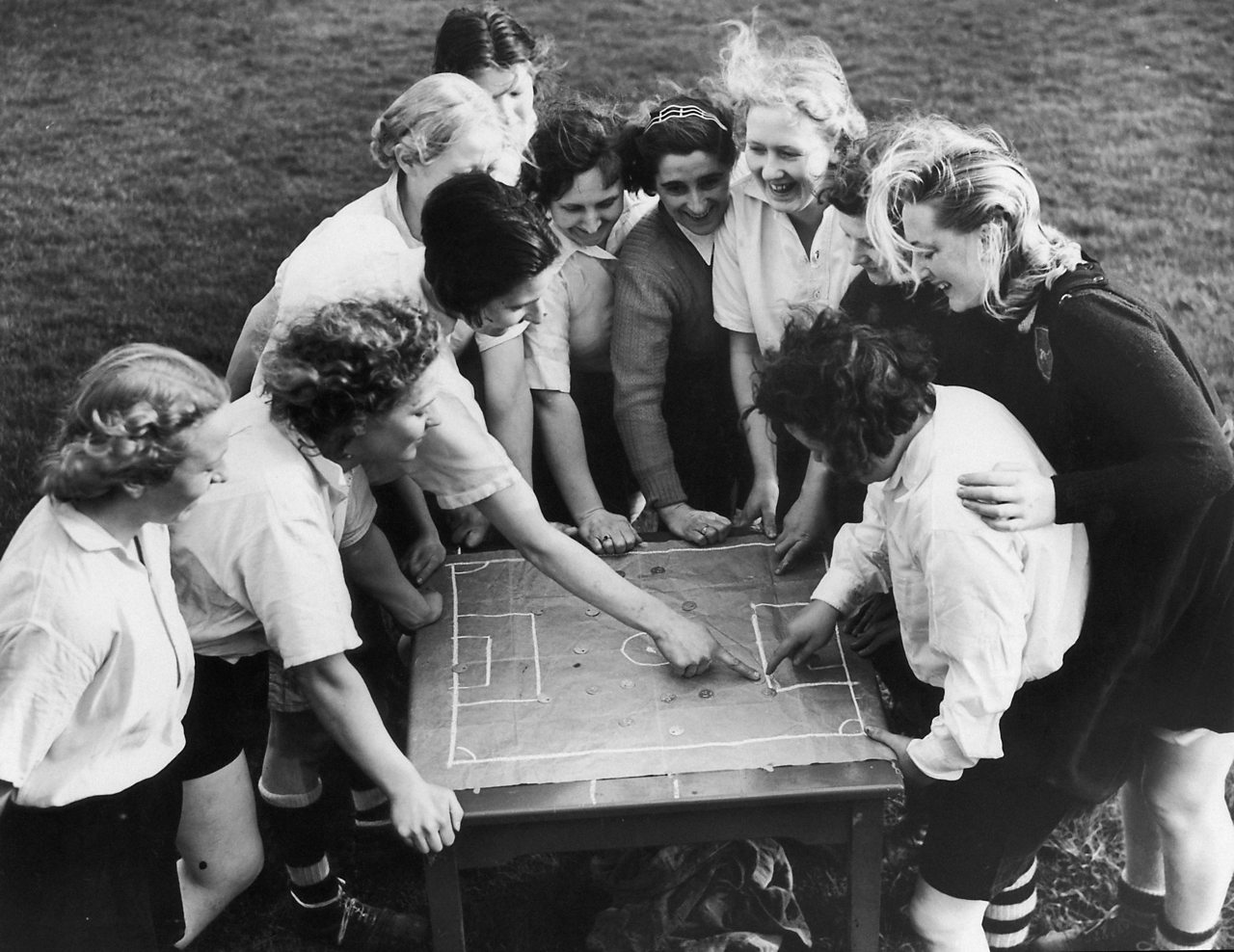 The Dick, Kerr ladies football team going over tactics