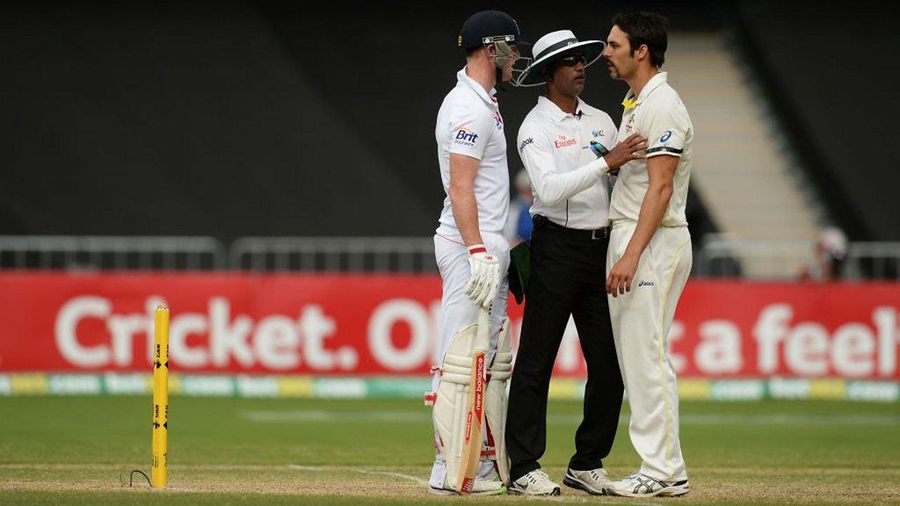 England's Ben Stokes and Australia's Mitchell Johnson arguing on the cricket pitch