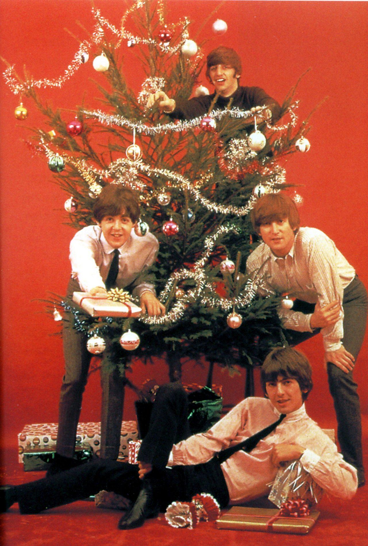 The Beatles around a Christmas tree