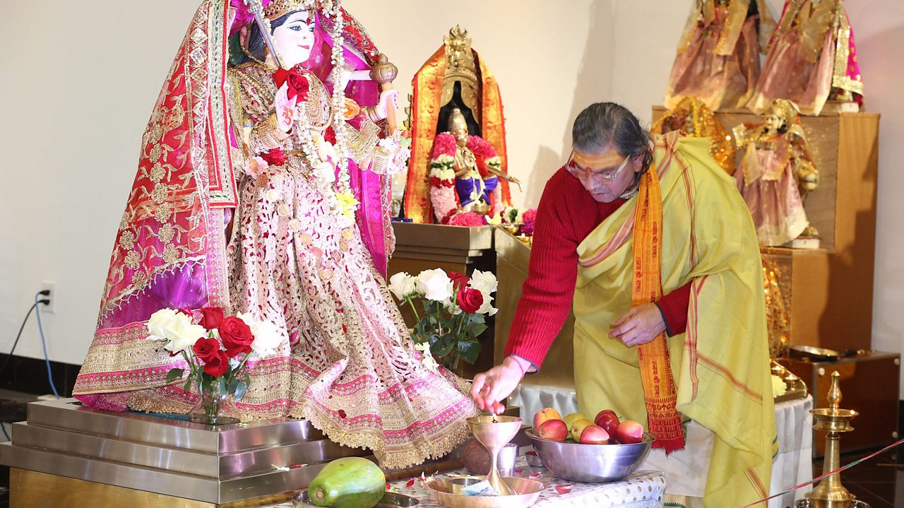 Hindus often worship at shrines to various deities. This is called puja. This is a shrine of Lakshmi during Diwali. Offerings are made in the form of food.