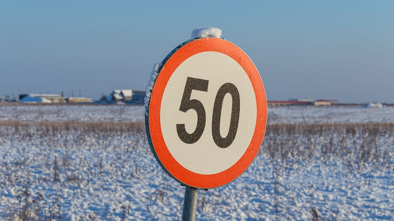 50mph speed limit sign in snow