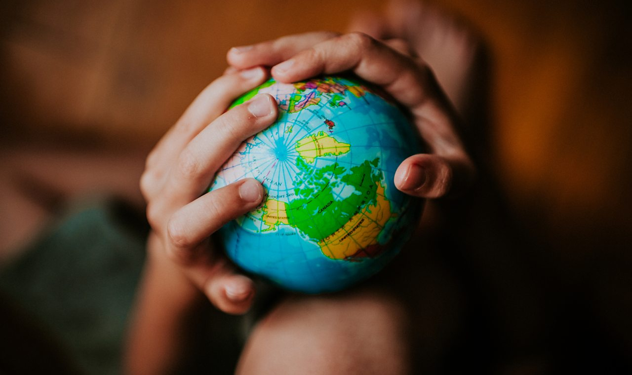 A globe being held by someone