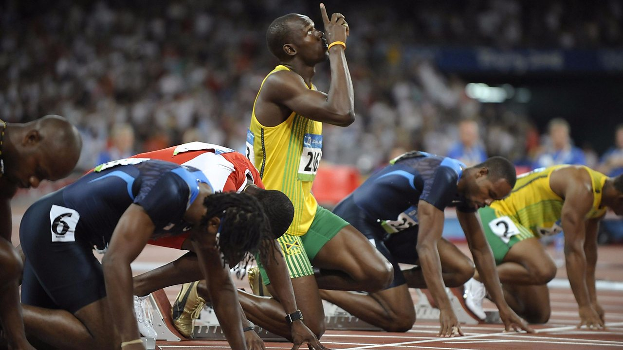 Usain Bolt and other runners get ready to run in the 100 metres at the Olympic Games